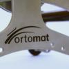 Navíjecí strojek OrtoMat logo
